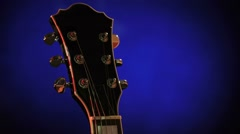 Acoustic-electric guitar on a dark blue background. sheet music, luminous notes Stock Footage