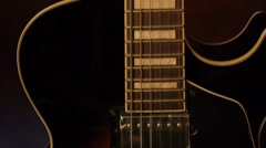 Acoustic-electric guitar on a dark background Stock Footage