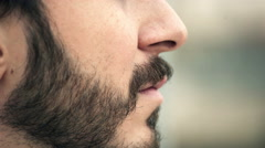 Profile of handsome man with a beard looking at something Stock Footage