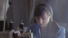 . Beautiful dark-haired woman sews clothes. Women's interests Stock Footage