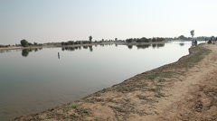 Pond at Rural area Rajasthan India Stock Footage