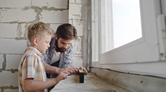 Helping Dad with House Renovation Stock Footage