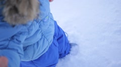 The legs are buried in the snow closeup Stock Footage