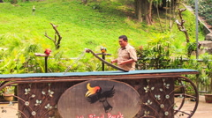 Guy Shows Parrot Tricks with Slide in KL Bird Park Stock Footage