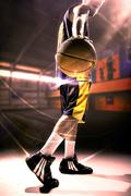 Silhouette view of a basketball player holding basket ball Stock Photos