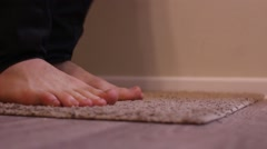 Man Jumping on the Carpet With Bare Feet, and Wiggle Your Toes. Stock Footage