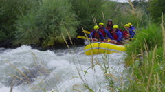 Group of people white water rafting in slow motion Stock Footage