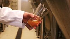 Brewer testing beer Stock Footage