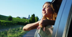 A woman in the car breathes, plays and smiles happy and carefree. Stock Footage