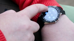 Man enjoys the applications and features installed in smart watches Stock Footage