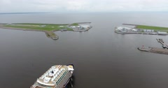 Aerial of cruise ship and Saint-Petersburg Flood Prevention Facility Complex Stock Footage