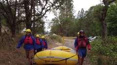 Group of people white water rafting carry raft together Stock Footage