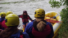Group of people white water rafting get instructions Stock Footage