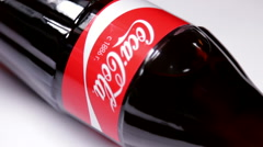 Coca-Cola is a carbonated soft drink sold Stock Footage