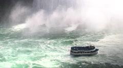 People in ferry enjoying view of majestic Niagara Falls Stock Footage