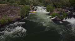 Aerial shot of people white water rafting on Rouge River, Oregon Stock Footage