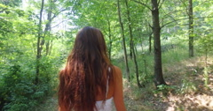 A woman surrounded by nature breathes, plays and smiles happy and carefree. Stock Footage