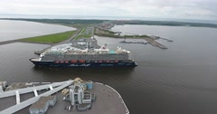 Aerial view cruise ship and Saint-Petersburg Flood Prevention Facility Complex Stock Footage