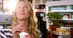 Portrait of woman drinking milkshake with a straw Stock Footage
