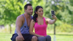 Athletic couple at park take selfies together Stock Footage