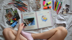 Creating photo book for child with Down's syndrome Stock Footage