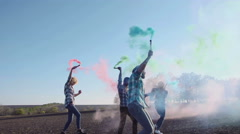 Dancing colored smoke grenades Stock Footage
