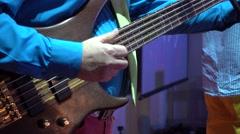 Man plays bass guitar Stock Footage