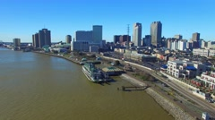 Aerial view of New Orleans skyline along Mississippi river Stock Footage