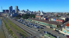 New Orleans buildings, river and rail tracks, aerial city view Stock Footage