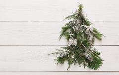 Christmas tree background at white wood with copy space Kuvituskuvat