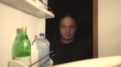 Man opens fridge and takes bananas Stock Footage