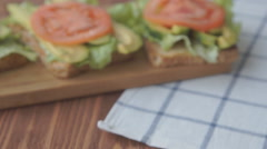 Sandwich with avocado and tomato Stock Footage