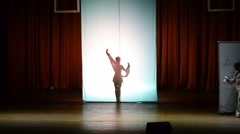 The dancer dances behind a white background, dance of a shadow. Stock Footage