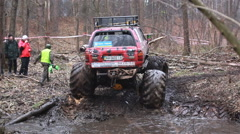 KIEV, UKRAINE - November 28, 2015: Big Foot rides in the forest on a dirt Stock Footage