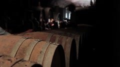 Excursion to the wine cellar with wine barrels at a winery Stock Footage