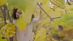 Beautiful black girl walking in autumn forest with yellow maple bouquet in her Stock Footage