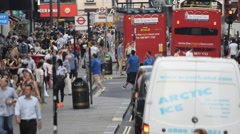 LONDON – JULY 2015: Tourists and traffic along city streets. London attracts 30 Stock Footage