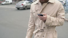 Man with Beard Walking with Phone Stock Footage