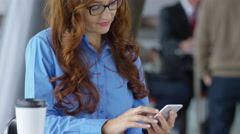 Young businesswoman talking on cell phone Stock Footage