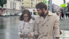 Young Man and Woman Looking at Tablet on Zebra Crossing Stock Footage