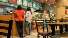 Time Lapse - people entering, lining up and buying sandwiches at Subway Stock Footage