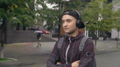 Man in Headphones Enjoying Music Outside Stock Footage
