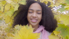 Portrait of beautiful black teen girl with yellow maple bouquet Stock Footage