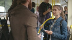 Young Man and Woman Talking in Trolleybus Stock Footage