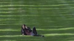 With Cell Phone In The Park Stock Footage