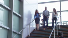 Group of business people walking down stairs Stock Footage