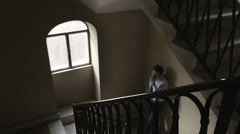 the break of the businessman: light a cigarette on the stairs Stock Footage
