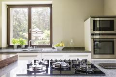 Kitchen granitic worktop with a cooker Stock Photos