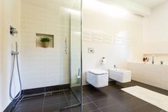Tiled bathroom interior Stock Photos