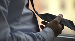 Businessman hand touching his tie nervously Stock Footage